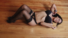 Latina girl lying on back in lingerie Stock Footage
