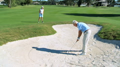 Retired Couple Playing Golf Stock Footage