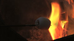 Roasting marshmellow on a stick Stock Footage