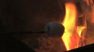 Roasting marshmellow on a stick Stock Footage