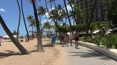 Waikiki beach with umbrellas and palms Stock Footage