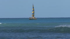 Waikiki boat with yellow and blue sail  Stock Footage