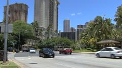 Waikiki busses on street Stock Footage