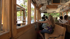 Waikiki people on trolley  Stock Footage