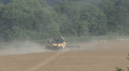Stock Video Footage of Combine harvester on rapeseed.