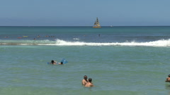 Waikiki swimmers reed and sailboat Stock Footage