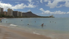 Waikiki swimmers and Diamond Head  Stock Footage