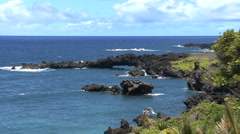 Zooms from lava sea arch Stock Footage
