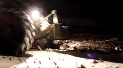 Tractor plowing at night - stock footage