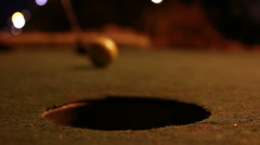 Crazy Golf - In the hole - floodlit Stock Footage