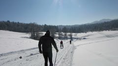 HD: Cross-Country Skiing Down The Slope Stock Footage