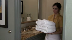 Maid walks in and out of bathroom V2 - HD Stock Footage