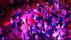 Synchronized dancing crowd of young people in a nightclub, with sound - stock footage