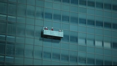 Window washers going up - stock footage