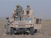 Cleaning the Humvee on the desert Stock Footage