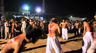 Stock Video Footage of Ritualistic Self Flagellation at Ashura Festival in Karachi, Pakistan