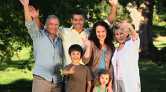 Family waving at the camera Stock Footage