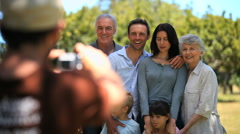 Familys picture taken by a passerby Stock Footage