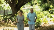 Old woman and her husband running Stock Footage