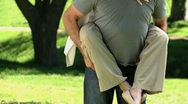 Elderly man carrying his aged wife Stock Footage