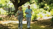 Elderly couple running Stock Footage