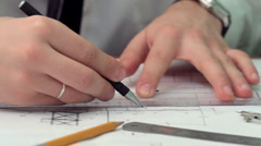 young engineer works with drawings. HD dolly. - stock footage