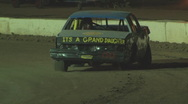 Stock Video Footage of Colorado dirt track beginner stock car on three wheels