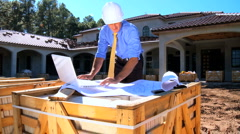 Architect Working with Blueprints & Laptop Stock Footage