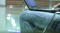 Laptop in airport Stock Footage