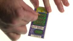 Lottery scratch n win ticket Stock Footage