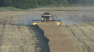 Stock Video Footage of New Holland combine harvester finishing rapeseed harvest.