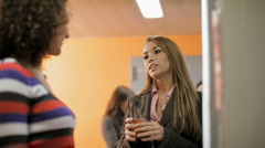 Young women having coffee break - stock footage