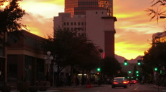 HD wide tilt down Colorful sunset clouds over downtown Stock Footage