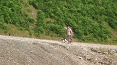 Couple and Dog Walking in Lake District Stock Footage