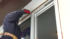 Home improvement, #15 installing window screwing in screws, medium Stock Footage