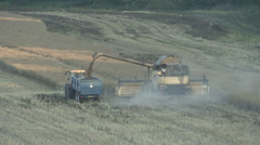 New Holland combine harvester retracts boom. Stock Footage