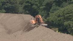 Excavator building a floodbank. Stock Footage