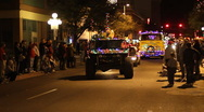 Stock Video Footage of Festival of lights parade - old squad car and fire engine - 11