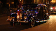 Stock Video Footage of Festival of lights parade - fun and crazy people and vehicles old gangster  - 36