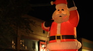 Stock Video Footage of Festival of lights parade - Santa Clause blow up figure - 39