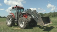 Stock Video Footage of Tractor turning manure pile 06