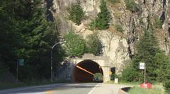 Motorcycle Thru Mountain Tunnel Stock Footage