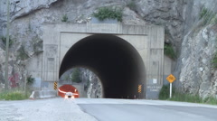 Truck Thru Mountain Tunnel Stock Footage