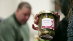 Woman buys Jar of Pickles Stock Footage