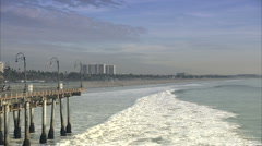 waves crash against boardwalk - stock footage