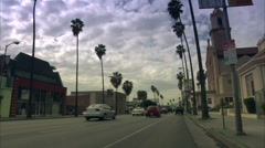Palm lined street Stock Footage