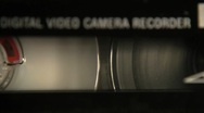 Stock Video Footage of Video Camera Tape Rewinding