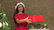 Stock Video Footage of Beautiful Asian Woman With Christmas Gift