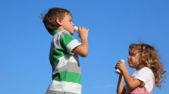Boy with girl standing and drink yoghurt Stock Footage