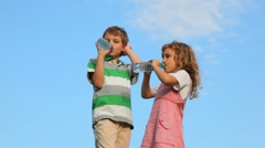 Boy with girl standing and drink water from plastic bottles Stock Footage